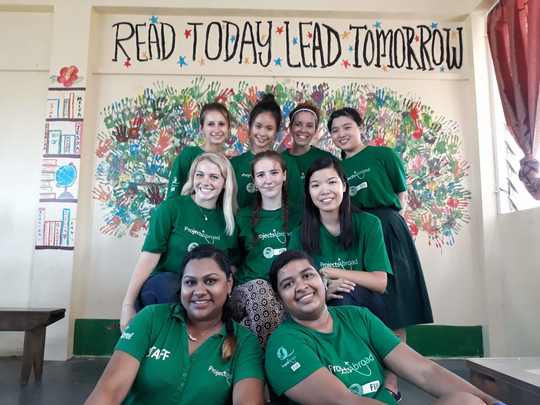 A group of high school volunteers joined to create a mural to promote literacy in our High School Special Childcare & Community Village project Fiji.